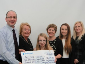 Pictured from left to right:  Choir Director, Mark Ritzmann with Soroptimist representative, Bethan Evans are seen presenting a cheque to Mrs.Julie Harvey and young members of Ice Cool Kids.